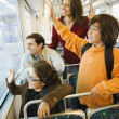 Hispanic family waving from train — Stock Photo