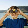 Hispanic boy looking through binoculars — Stock Photo