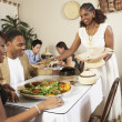 African American couple eating at restaurant — Stock Photo