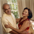 Senior Hispanic couple dancing — Stock Photo