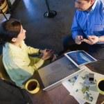 uomo e donna in riunione d'affari — Foto Stock