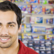 Pacific Islander man in toy store — Stock Photo