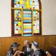 African senior talking in church — Stock Photo
