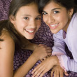 Multi-ethnic girls touching heads — Stock Photo