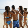 South American friends walking on beach — Stock Photo