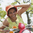 Senior African American woman riding motor scooter — Stock Photo