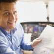 Mholding map in airplane cockpit — Stock Photo #23306848