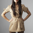 Stock Photo: Asiwomwearing belted jacket