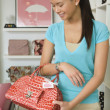 Asian woman shopping in boutique — Stock Photo