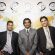 Indian businessmen in front of global map — Foto de Stock