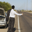 Hispanic man broken down on side of road — Stock Photo