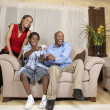 African father and son playing video games — Stock Photo