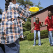 Stock Photo: Africfamily playing in backyard