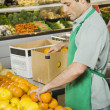 Hispanic man working in grocery store — Stock Photo