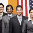 Indian businesspeople in front of flags — Stock Photo