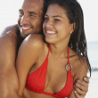 South American couple hugging at beach — Foto Stock