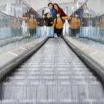 Hispanic family on escalator — Stock Photo