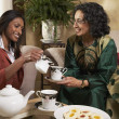 Indian mother and adult daughter having tea — Stock Photo