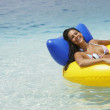 South American woman in raft - Stock Photo