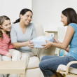 Hispanic girl giving gift to mother — Stock Photo