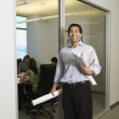 Hispanic businessman next to conference room — Stock Photo