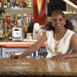 Portrait of African woman bartender — Stock Photo