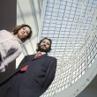 Stockfoto: Low angle view of Hispanic businesspeople