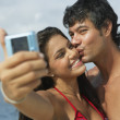 South American couple taking own photograph — Stock Photo