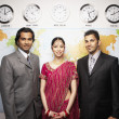 Indian businesspeople in front of global map — Stock Photo