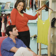 Hispanic couple shopping in clothing store — Stock Photo
