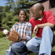 African father and son with baseball glove — Stock Photo