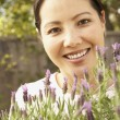 Asian woman holding lavender plants — Stock Photo