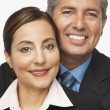 Stock Photo: Hispanic professional couple hugging