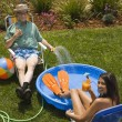 Multi-ethnic couple next to kiddie pool — Stock Photo