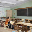 Mixed Race boy in empty classroom — Stock Photo
