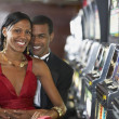 Couple next to slot machines — Stock Photo