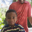 African American grandfather smiling at grandson — Stock Photo