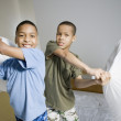 African American brothers having pillow fight — Stock Photo