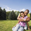 African American couple hugging — Stock Photo