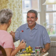 Senior Hispanic couple eating — Stock Photo