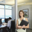Hispanic businesswoman next to conference room — Stock Photo