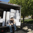 Middle Eastern man sitting on moving truck — Stock Photo