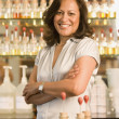 Hispanic female sales clerk at perfume store — Stock Photo