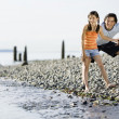 Mixed Race father and daughter at rocky beach — Stock Photo