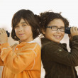 Hispanic brother and sister holding binoculars — Stock Photo