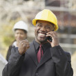 African American businessman cheering on cell phone - Stock Photo