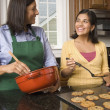 Hispanic mother and daughter baking cookies — Stock Photo
