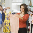 Hispanic couple shopping in clothing store — Stok fotoğraf
