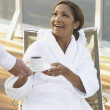 African American woman in spa robe with coffee — Stock Photo