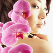 Asian woman with flowers — Stock Photo